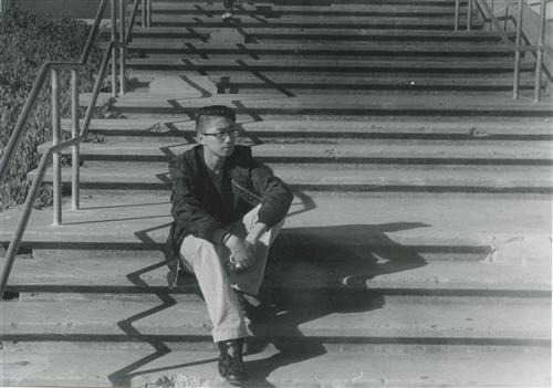 Guy sitting on stairs
